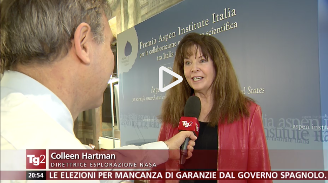 video still of Colleen Hartman being interviewed on Italian television